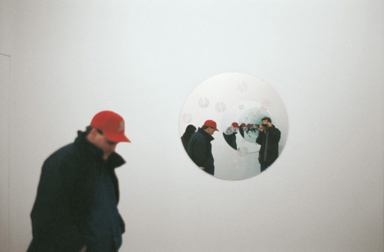 Feedback, 1994, two circular mirrors with compact discs