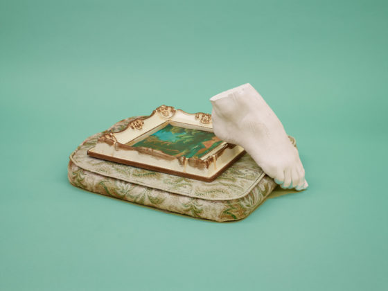 Untitled (Balancing foot on painting on cushion), 2014, pigment print